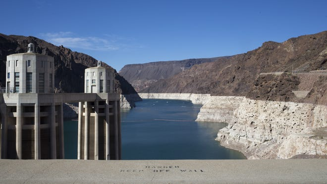"""Hoover Dam and Lake Mead on June 19, 2015. A high-water mark or """"bathtub ring"""" is visible on the shoreline."""