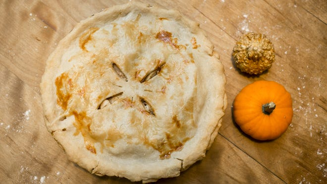 Dylan Freeman, the son of the couple behind Vermont Rolling Pin & Co., makes the recipe for his award-winning apple pie in South Burlington on Wednesday, November 16, 2016.