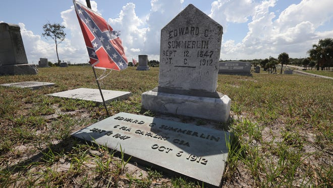 A grave marker for Confederate soldier Edward Summerlin is seen at the Riverview Memorial Park on Friday, Sept. 1, 2017, in Fort Pierce. The grave is one of several Confederate soldiers buried throughout the cemetery.