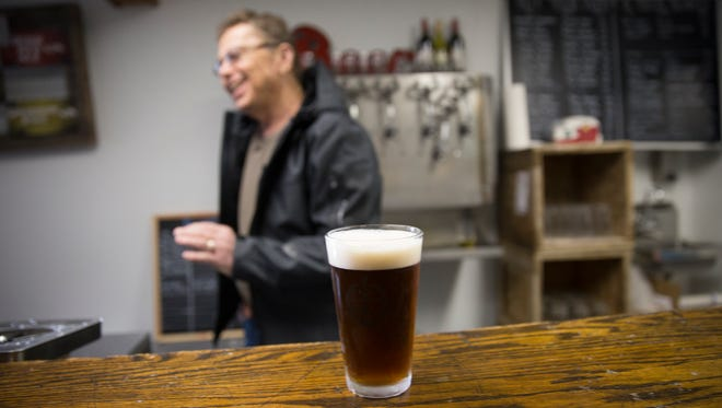 Mike Paschall, owner of 550 Brewing, works behind the bar at his Aztec brewpub on Jan. 18.