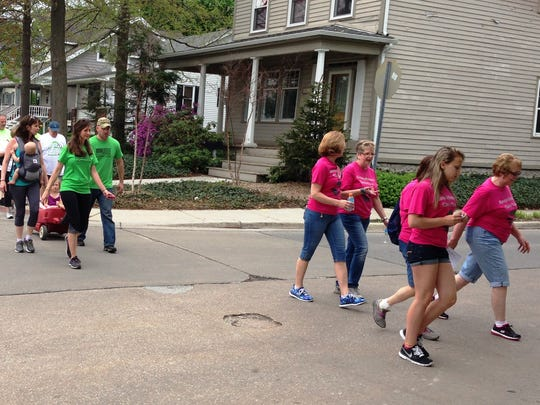 Walkers make the turn at Brown Street in St. Clair during a Walk MS fundraising event Saturday for the National MS Society.