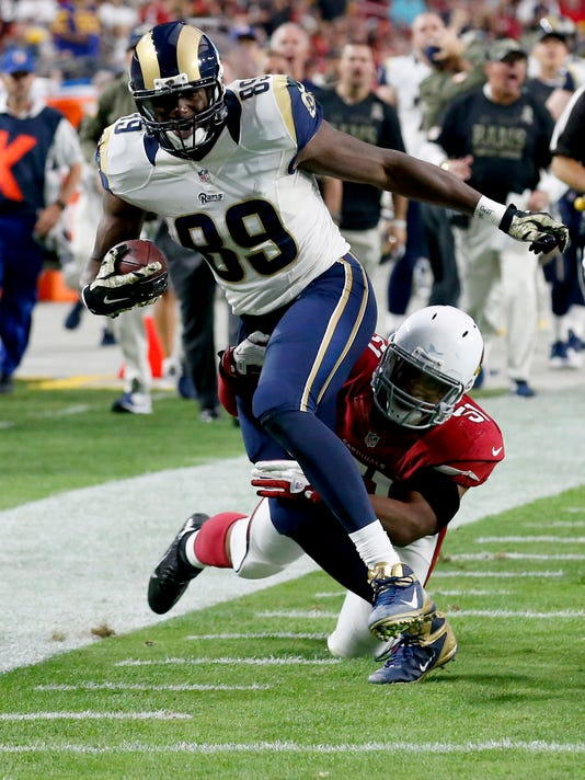 St. Louis Rams tight end Jared Cook (89) is tackled by Arizona Cardinals inside linebacker Kevin Minter during the second half of an NFL football game, Sunday, Nov. 9, 2014, in Glendale, Ariz. (AP Photo/Ross D. Franklin)