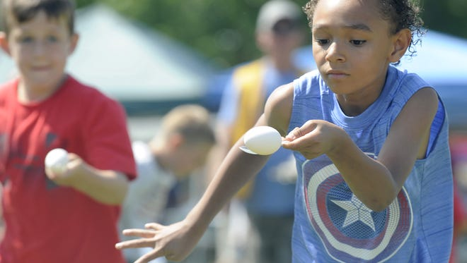 Christopher Giorgi, 8, of Carson City dashes to a first-place finish in the egg race.