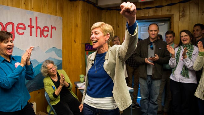 U.S. Senate candidate Deborah Ross cheers along with Buncombe County Democrats in Asheville Monday while thanking them for their support and final push one day before Election Day.