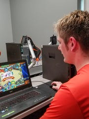 J.T. Carman of Leo, Ind. hones his Hearthstone skills during an Indiana Tech eSports practice session.