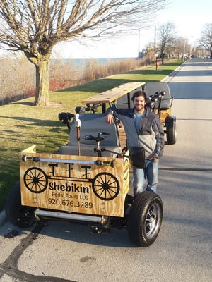 Justin Vannieuwenhoven posing with the Shebikin' Pedal Tours vehicle.