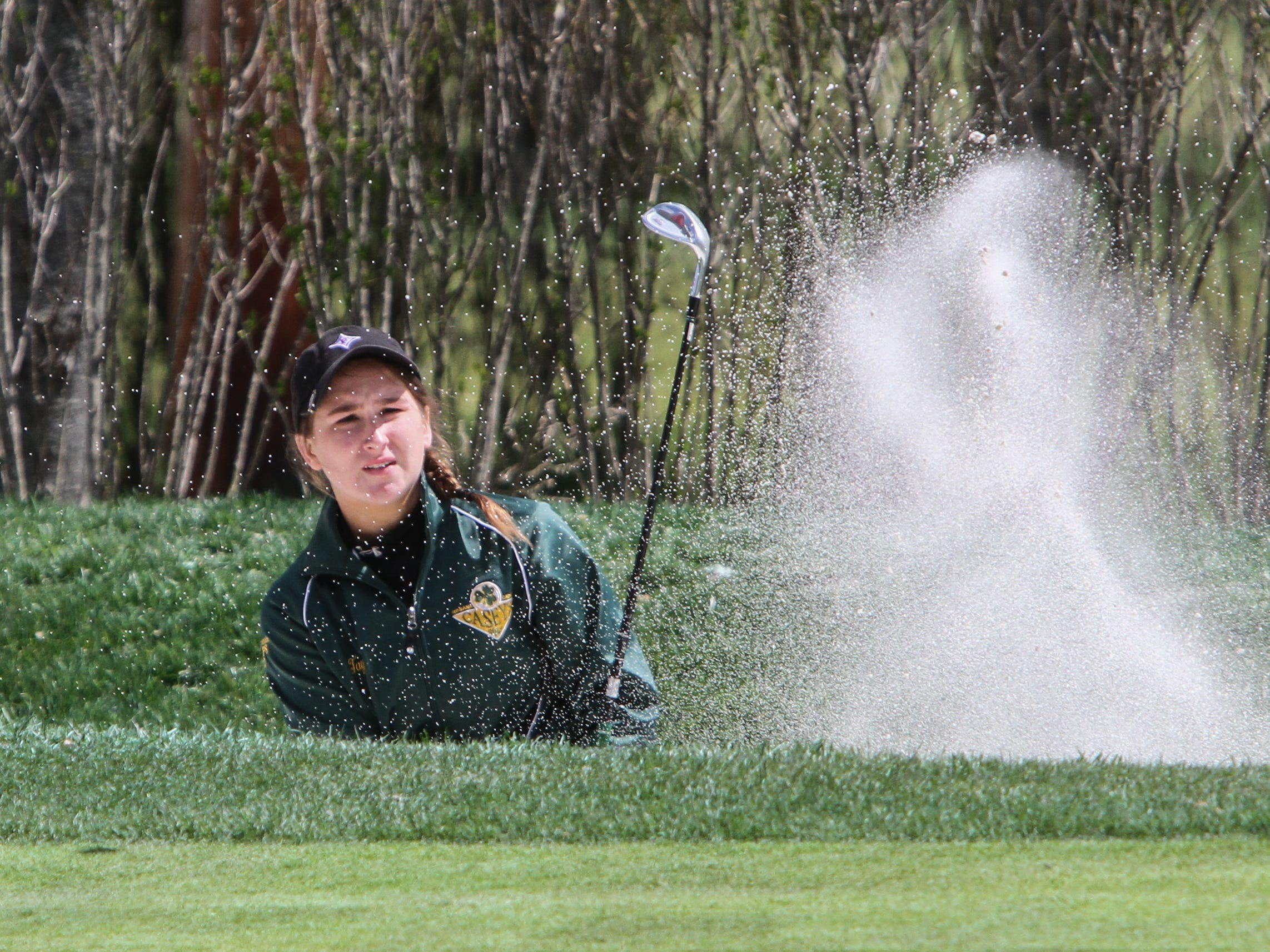 Nicole Totland of Red Bank Catholic blasts out of a greenside bunker at Deal Golf & Country Club on Monday on her way to the individual title at the Shore Conference Tournament, while leading the Caseys to the team title.