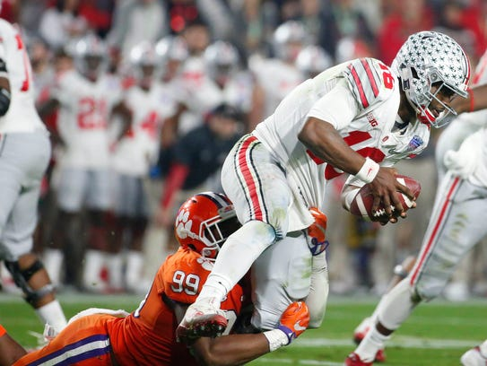 Ohio State quarterback J.T. Barrett gets sacked by