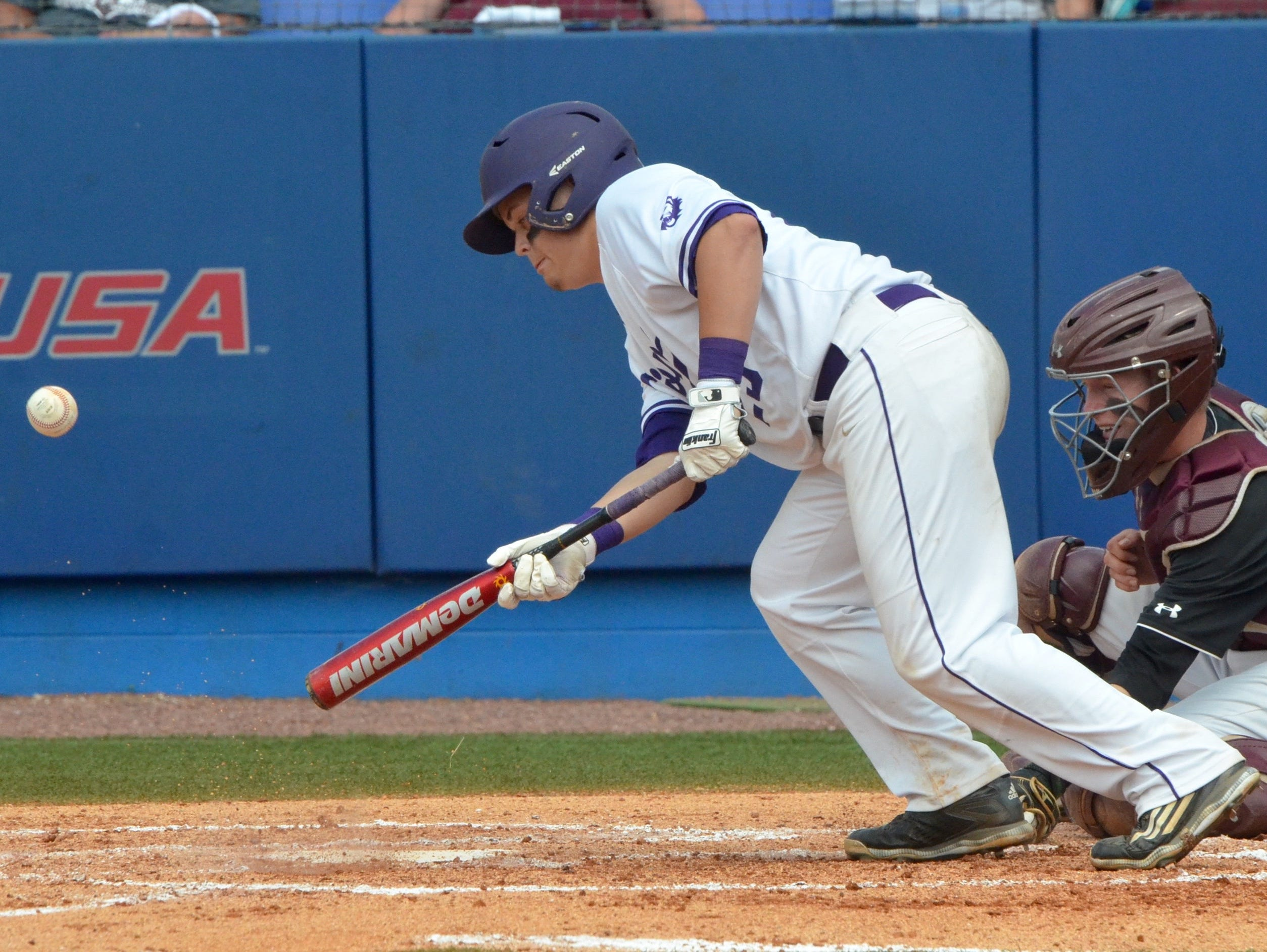 Christ Presbyterian Academy's freshman Knox Preston lays down a bunt during the second inning of Friday's TSSAA Class AA state baseball championship game at MTSU's Reese Smith Jr. Field.
