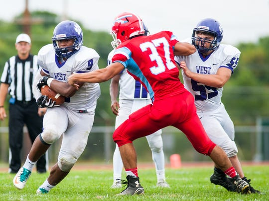 Lorenzo Hernandez of Cherry Hill West picks up some yardage during action in Saturday's WJFL Constitution game against Pennsauken.