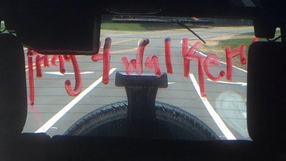 """Jackson Prep student Mary Grace Simpson posted this photo on Twitter to honor the memory of classmate Walker Wilbanks. """"The force of rain will have to take this off because I'm sure not going to,"""" she wrote."""