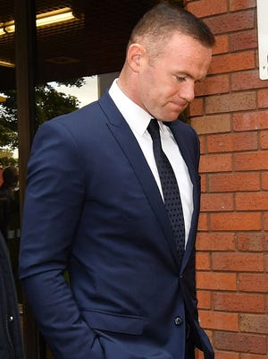Wayne Rooney leaves Stockport Magistrates Court after facing a drink-driving charge on Sept. 18, 2017 in Stockport, England. T