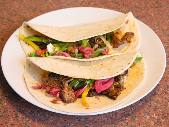 Mijal Tohi's steak fajitas are a regular on the family table.