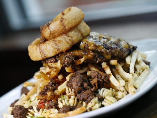 The Gate House is one of the restaurants participating in Plate-A-Palooza at Comedy at the Carlson Tuesday, Jan. 29. The Gate Plate (homemade pasta, rosemary fries and a half-pound burger topped with meat sauce and onion rings) is pictured.