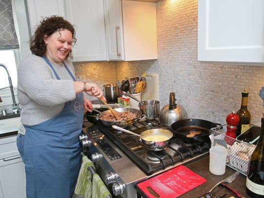 Jennifer Stearns prepares risotto in her Wauwatosa kitchen.