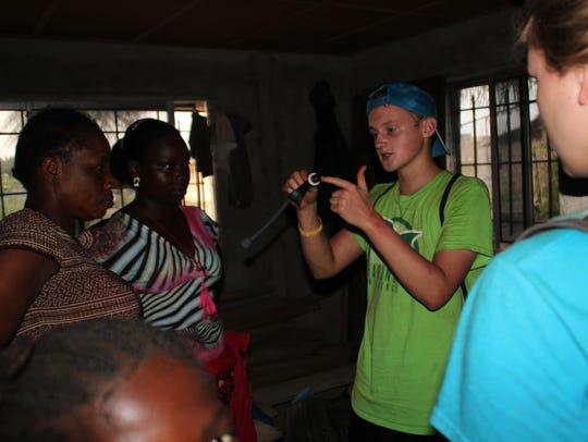 Delta golfer Joseph Tempest showing a family in Liberia
