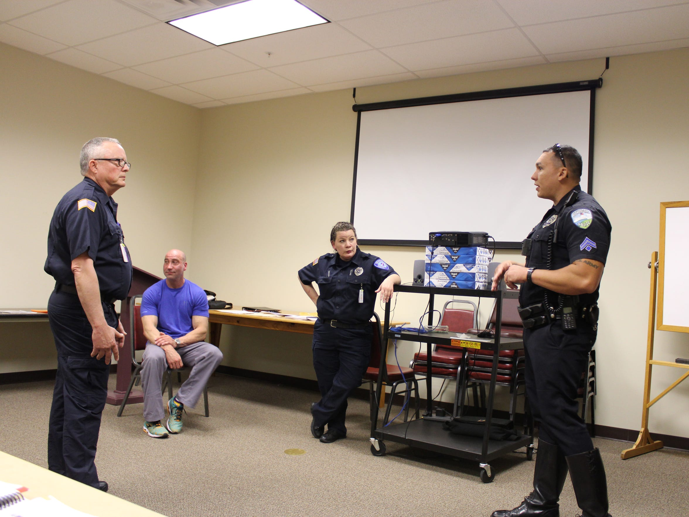 Cpl. Vern Rennier (right) talks to Christus St. Frances