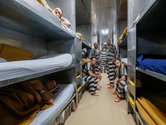 Inmates congregate in the bunk area of the new trailer jail on Thursday, Dec. 21, 2017.