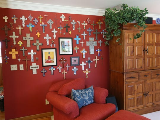 This wall of crosses in the living room started with a single cross given to Barbara Kluth by her husband.