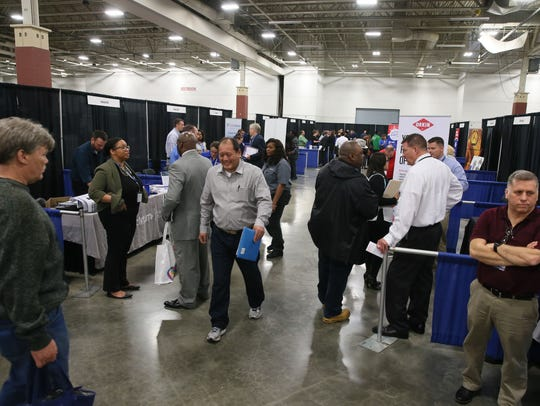 Potential workers seek employment at a career expo held by the Wisconsin Department of Workforce Development at the State Fair Expo Center.