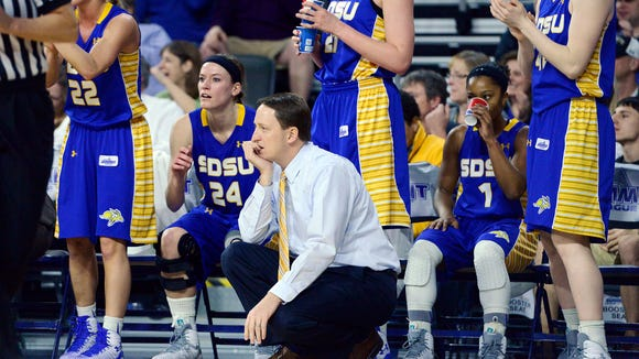 SDSU head coach, Aaron Johnston watches over his team as they plat USD in Tuesday's Summit League women's basketball championship at the Denny Sanford Premier Center in Sioux Falls, S.D. March 10, 2015. SDSU beat USD 72-57.