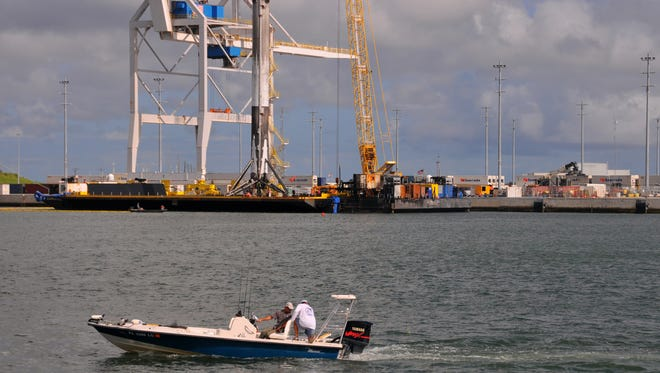 A SpaceX Falcon 9 booster that launched a commercial communications satellite from Kennedy Space Center on Wednesday arrived at Port Canaveral early Sunday. It was towed in on the Of Course I Still Love You drone ship after it successfully landed shortly after liftoff.