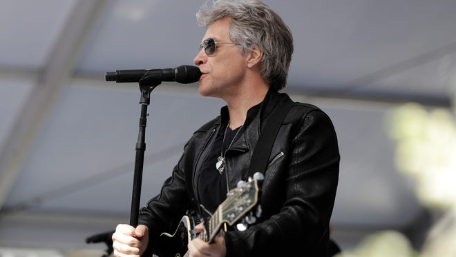 Jon Bon Jovi performs during a surprise appearance at the Fairleigh Dickinson University commencement ceremony.