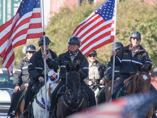 The Pensacola Veterans Day Parade travels down Bayfront