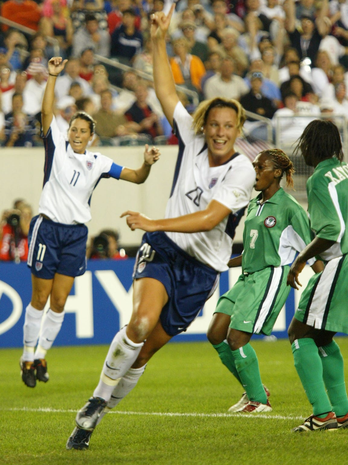 Abby Wambach celebrates her second-half goal with teammate Julie Foudy against Nigeria during their World Cup game in Philadelphia on Sept. 25, 2003.