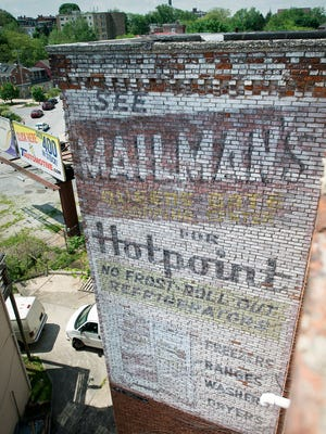 A painted sign for Mailman's that occupied the former Weaver Organ and Piano Co. building at 127 N. Broad Street in York after it left in 1959. The sign is now partially obscured from East Philadelphia Street by a building that is now two stories.