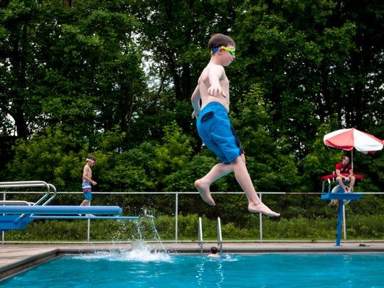 Ben Lien, 9, of Port Huron, jumps off the diving board