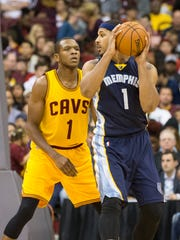 Grizzlies forward Jarnell Stokes (1) looks for an outlet pass under pressure from Cavaliers guard James Jones (1) at the Schottenstein Center on Oct 12, 2015. Memphis won 91-81.