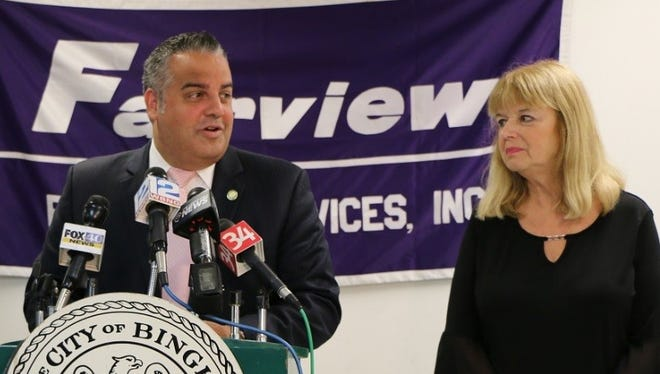 Binghamton Mayor Richard David and Michele Napolitano, executive director of Fairview Recovery Services, right, discuss the intensive care navigator program Wednesday.