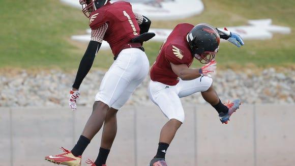 """MARK LAMBIE-EL PASO TIMES  El Dorado receiver Tyquez Hampton, left, celebrates his touchdown with teammate Cameron Covington Thurday on the night's first touchdown. """