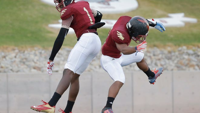 """MARK LAMBIE-EL PASO TIMES  El Dorado receiver Tyquez Hampton, left, celebrates his touchdown with teammate Cameron Covington Thurday on the night's first touchdown. """