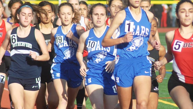 Hawthorne 800-meter runners Megan Knepper (19), Mackenzie Conroy (10) and Nicole Bertollo (1) trying to break out of the pack at the NJIC Colonial Division meet.