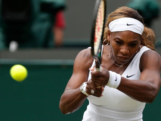 Serena Williams of U.S. plays a return to Chanelle Scheepers of South Africa during their women's singles match at the All England Lawn Tennis Championships in Wimbledon, London, Thursday, June 26, 2014. (AP Photo/Ben Curtis)