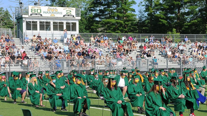 Graduates received diplomas during an outdoor ceremony at Tantasqua Regional High School in Sturbridge Saturday.