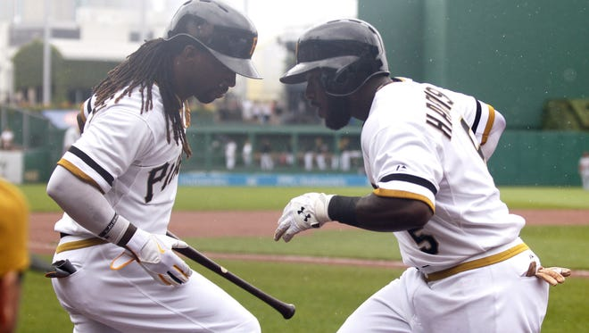 Pirates center fielder Andrew McCutchen was the 2013 NL MVP, but he thinks teammate Josh Harrison is worthy of the 2014 award.