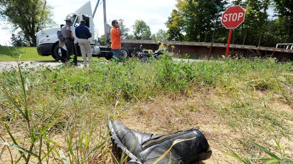 A boot lays about 15 yards from the scene of an accident involving a motorcyclist and a semi at the corner of Smith Road and Ohio 13 south of Bellville.
