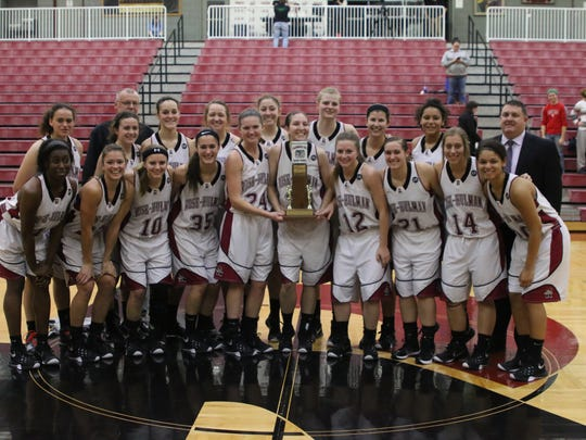 Rose-Hulman's women's basketball team poses with the Clabber Girl Trophy.