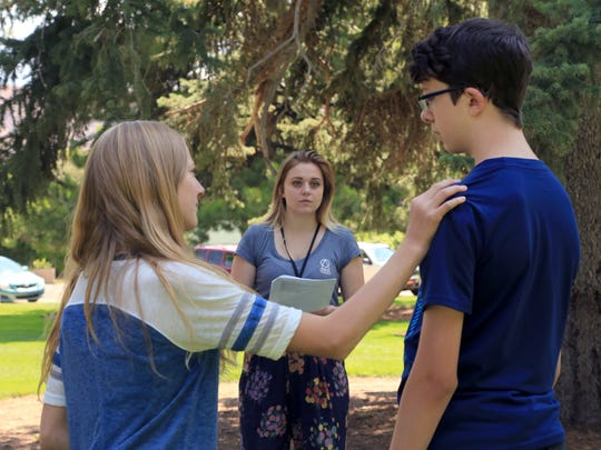 "Scene coach Abbie Rose Nakken, center, helps Gwendolyn Cudkowicz and William Butler with a scene from ""As You Like It"" on July 13 during the Utah Shakespeare Festival's Junior Actors camp at Southern Utah University in Cedar City."