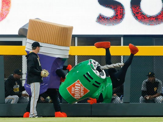 The Home Depot Tools entertain the crowd by racing around the outfield during a baseball game between the Atlanta Braves and the Pittsburgh Pirates Wednesday, May 24, 2017, in Atlanta. (AP Photo/John Bazemore)