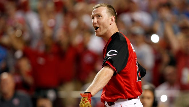 National League third baseman Todd Frazier (21) of the Cincinnati Reds reacts after winning in the 2015 Home Run Derby the day before the MLB All Star Game at Great American Ballpark.