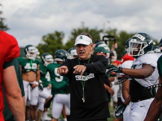 Michigan State football Mark Dantonio instructs his