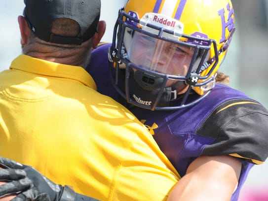 HSU's Reese Childress, right, celebrates with a fan