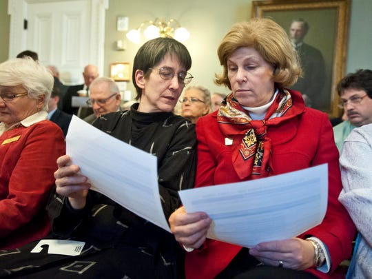 Rep. Ann Donahue, R-Northfield (left), and Rep. Eileen Dickinson, R-St. Albans, confer as they receive a briefing on the state budget shortfall during a meeting of the GOP caucus on the opening day of the Legislature at the Statehouse in Montpelier on Wednesday.