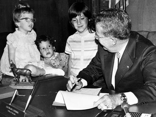 When she was a young child, Lisa Fischer (second from left) attended a ceremony with Gov. Jack Williams when he recognized the need for public schools to provide special education programs.