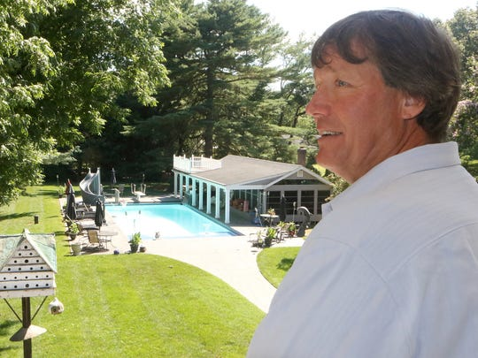 Mark Henderson beat his addiction and turned his life around and now operates a pool building business out of his Milford home. Henderson designed and built the pool and the pool house in back of his home.