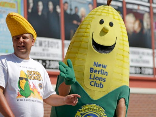 A New Berlin Lions Club ear of corn waves during the daily State Fair parade.